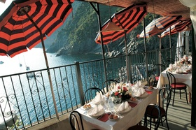 Reception on balcony on Cinque Terre cliff with ocean views