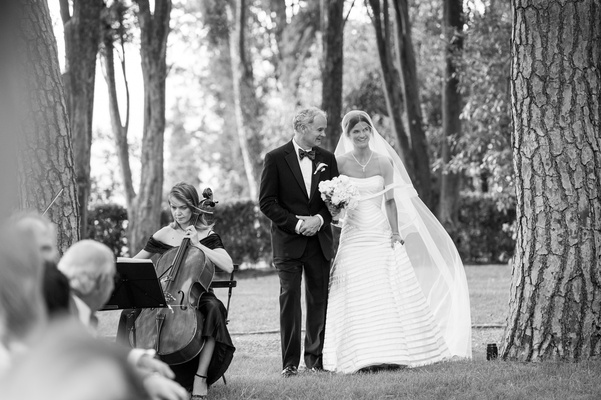 Black and white photo of a bride in a strapless Vera Wang gown with her father in a black tuxedo