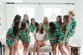 bride in white pajama short set, bridesmaids in pajama short set with tropical leaves