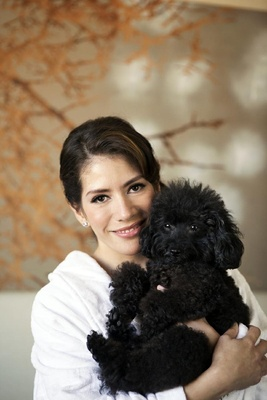 Bride getting ready with black poodle dog