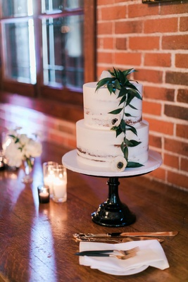 Wedding cake on cake stand with two layer wedding cake semi naked confection greenery anemone flower