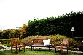 Malibu wedding wood lounge chair and bench area