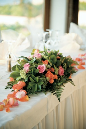 Colorful rose petals and flowers in greenery