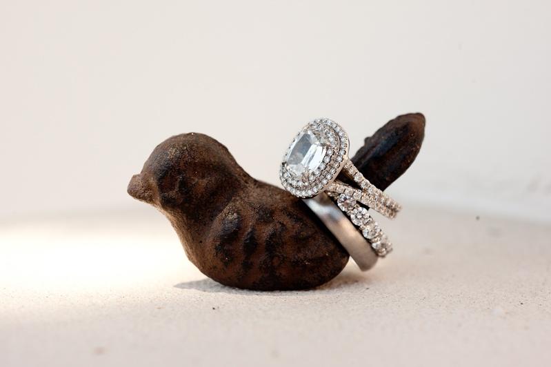 Wedding rings on brown bird ring holder