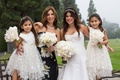 Bride with mother of bride and two daughters in tulle polka dot skirts dresses