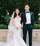 Bride in strapless wedding dress oscar de la renta mermaid groom with bow tie and tuxedo bouquet