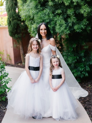 dancing with the stars cheryl burke with two flower girls white dresses black belt sash details