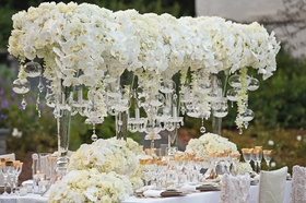 wedding tablescape with orchids, hydrangeas, roses, gold details