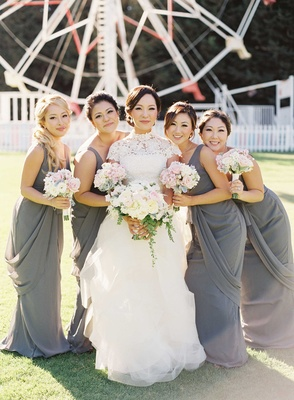 Bridesmaids in gray long bridesmaid dresses at Calamigos Ranch ferris wheel