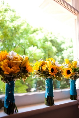 Sunflower and rose bouquet with blue ribbon