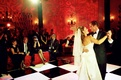 Bride and groom first dance on checker dance floor