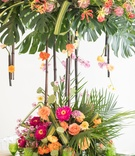 tropical wedding inspiration, two level centerpiece with bamboo, split leaves, palm fronds
