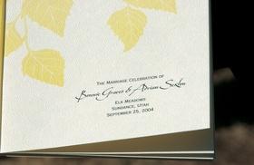 Ceremony program with yellow autumn leaves
