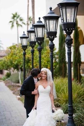Brandon Wood kissing bride on wedding day