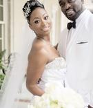 Bride in strapless Jasmine Bridal wedding dress and groom in white tux