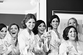 Black and white photo of bridesmaids in suite