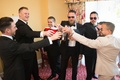 groom in armani collezioni, groomsmen cheers their drinks