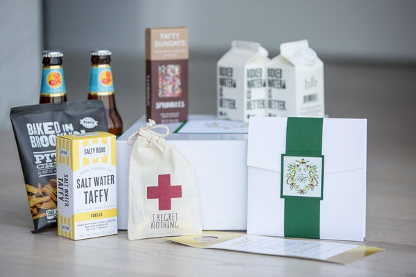 Wedding reception welcome box with boxed water, sprinkles, beer, taffy, emergency kit, pita chips