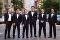 Wedding in New York CIty groom and groomsmen in tuxedos with bow ties
