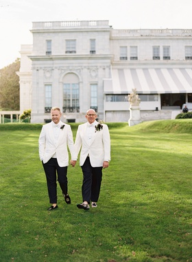 lgbtq gay same sex wedding grooms wearing white tuxedo jackets bow ties boutonniere rosecliff
