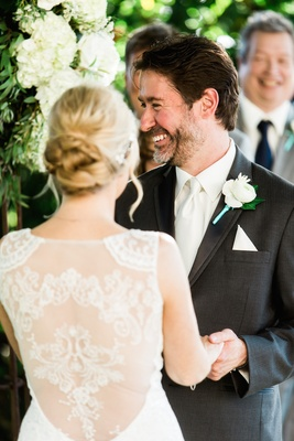 Bride in a Claire Pettibone gown with illusion back with CEO Ted Adams in grey suit, white tie