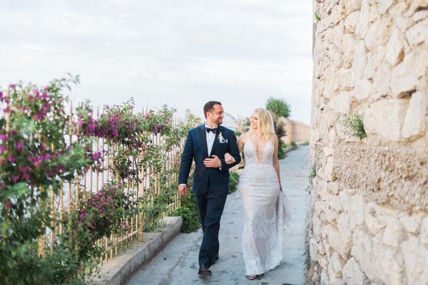 bride in galia lahav wedding dress with plunging neckline, groom in navy tuxedo, capri wedding