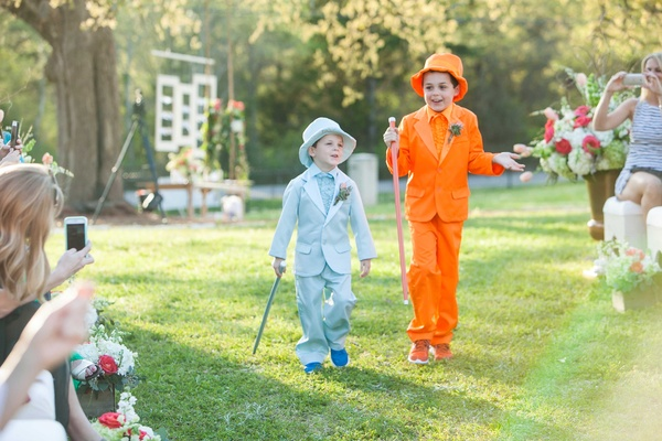 Ring bearers dressed in blue and orange tuxedos and top hats like Harry and Lloyd in Dumb and Dumber