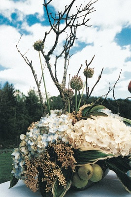 Rustic-inspired centerpiece with hydrangeas and pears