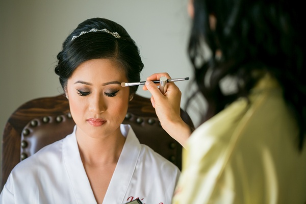 dolled up by lulu, eyemakeup applied to asian american bride in white robe