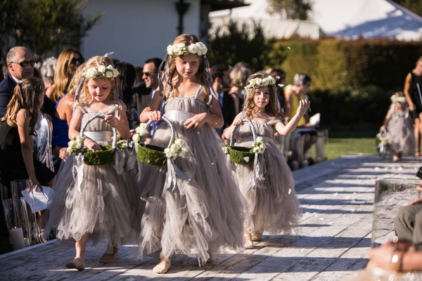 Three flower girls with flower crowns, moss green baskets and fluffy tulle grey dresses