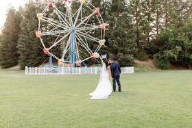 calamigos ranch wedding, bride and groom pose in front of ferris wheel