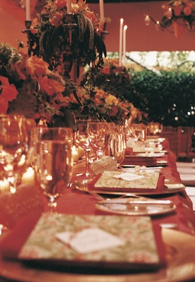 Orange and red wedding reception table decorations
