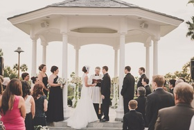 Bride and groom married beneath oceanfront rotunda