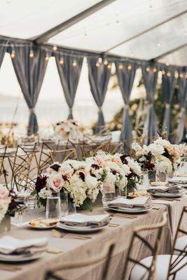 wedding reception neutral linens low centerpiece white blush burgundy grey drapes string lights