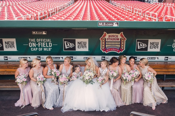 bridesmaids in sparkly long dresses mismatched styles and colors at Busch Stadium in St. Louis