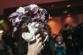 Bride holding up white and purple wedding flowers