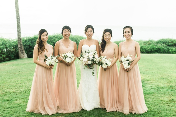 Wedding portrait bride with bridesmaids peach apricot bridesmaid dresses montage kapalua bay lawn