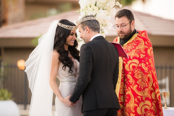 Wedding ceremony Armenian wedding tradition rite of crowning bride in galia lahav and wedding veil