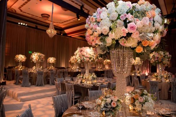 Wedding reception opulent centerpiece with pink orange white rose flowers white hydrangea crystals