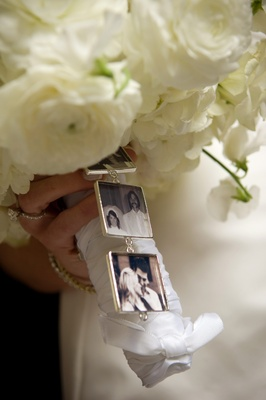 tiny pictures of family members hang from bouquet