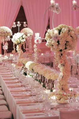 Rectangule table with runner of flower centerpiece