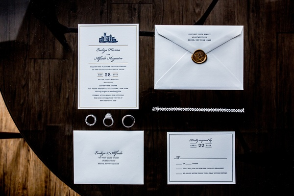 formal wedding invitation with blue print, bronze wax seal photographed with diamond jewelry