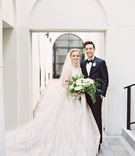 bride in high neck bateau neckline lazaro wedding dress veil groom in navy suit vibiana wedding