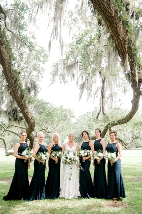 bride in v neck wedding dress bridesmaids in high neck lace dresses navy blue tree south carolina