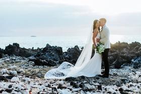 wedding portrait couple photo on lava rocks big island hawaii waimea venue crepe dress long veil