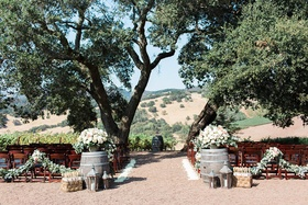 outdoor rustic winery ceremony space northern california sonoma wedding wine barrels natural trees