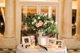 Wedding reception small table flower arrangement frames of late loved ones deceased family members