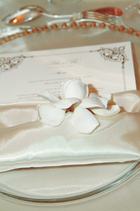 Wedding menu stationery in linen napkin with white flower