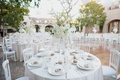 centerpieces with white flowers, manzanita branches, white linens