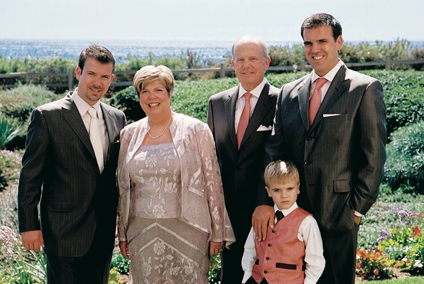 Father of groom in pinstripe suit and mother of groom in floral ensemble